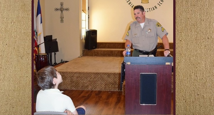 Pictured is Deputy Rule at the assembly, talking with the students.